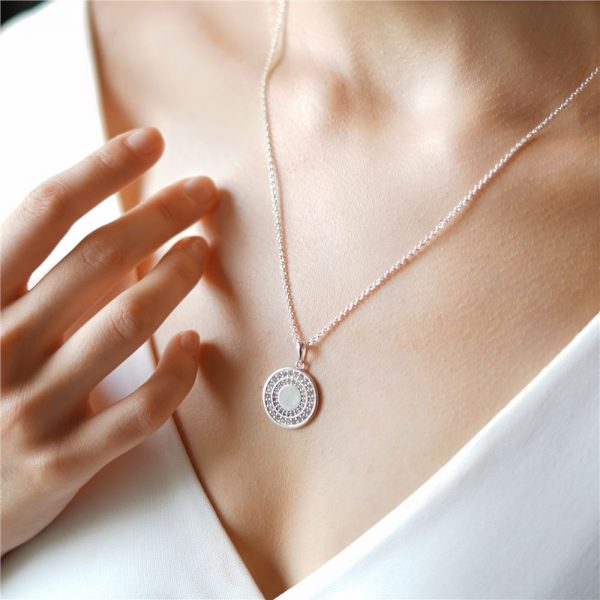 Circular Pendant with Clear Stones