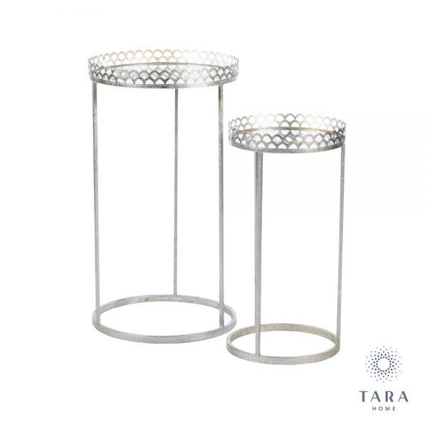 The key feature of these pretty mirrored tables is the 'frill' at the top, which is designed to keep whatever is on top safely in place.