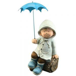 Boy on Log with Blue Umbrella