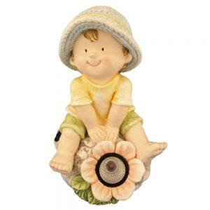Boy sits with Solar Flower