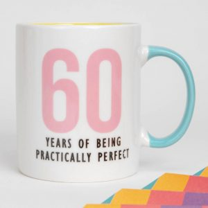 Wish someone special a happy birthday with this 60 YEARS OF BEING PRACTICALLY PERFECT porcelain mug. From Oh Happy Day!